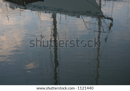 Reflection of a Boat docked at a harbor in Gimli, Manitoba, Canada - stock photo