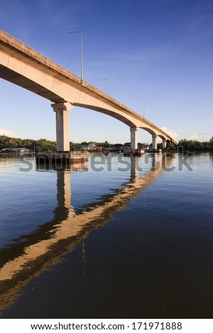 Reflection of a bridge with blue sky at Sabah, Borneo, Malaysia - stock photo