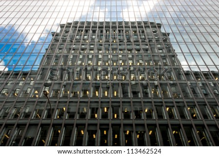 Reflection of a building in the windows of another building of Montreal. - stock photo