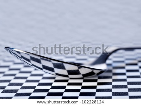 reflection of a chess field in a tablespoon - stock photo