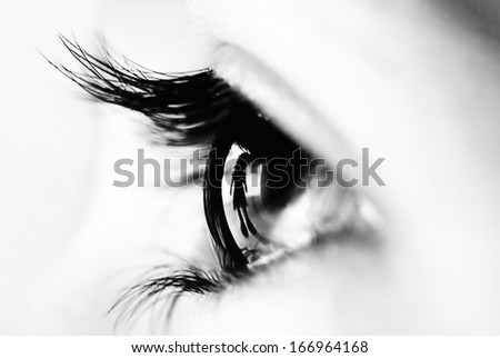 Reflection of a child inside the retina of an eye close up - stock photo