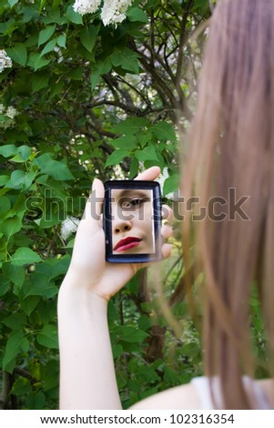 reflection of a girl in the mirror - stock photo