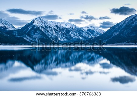 Reflection of a mountain landscape