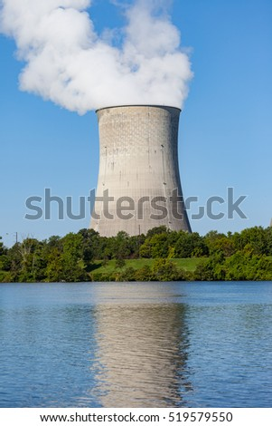 Reflection of a nuclear plant cooling tower in a river