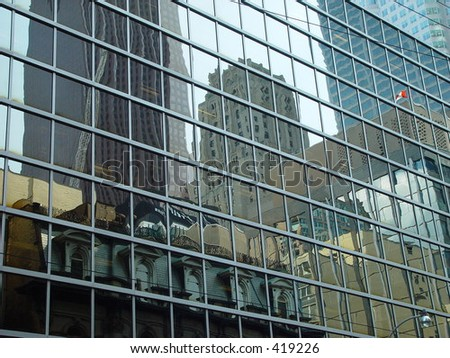 reflection of a street and its buildings in toronto, canada in the mirrored wall of a skyscraper