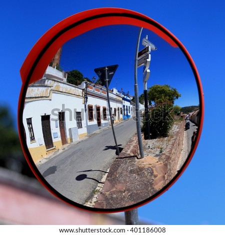 reflection of a street in a rear-view mirror/rear-view/reflection of a street in Portugal seen in a rear-view mirror - stock photo