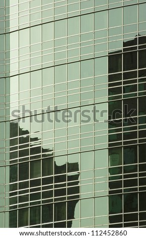 Reflection of an office building, Gurgaon, Haryana, India - stock photo