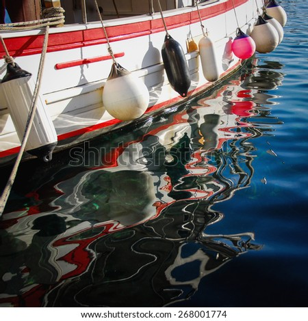 Reflection of boat in the sea - stock photo