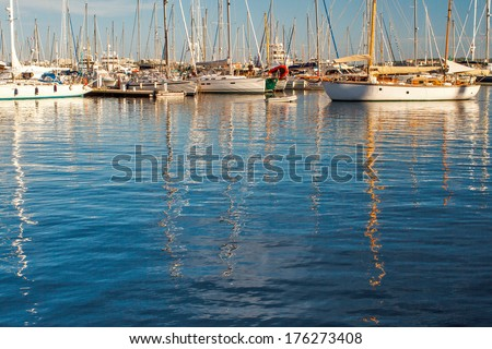 Reflection of boats in Cannes harbor - stock photo