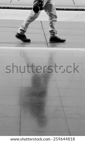 reflection of boy stand alone - stock photo