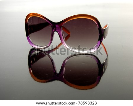 Reflection of brown sunglasses isolated