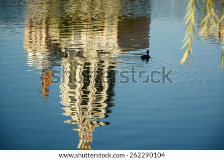 Reflection of buildings in water - stock photo