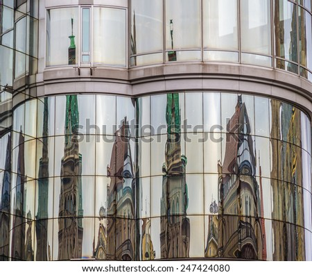 Reflection of  cathedral on office building - Stephansplatz, Vienna, Austria - stock photo