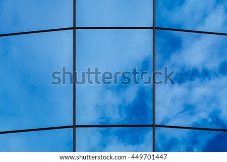 Reflection of cloud on mirror of the building with noon blue sky as background, great and fresh atmosphere for daily working