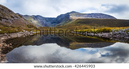 Reflection of clouds and the Macgillycuddy's Reeks and Carrauntoohil in Lough Eagher