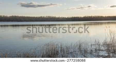 Reflection of clouds in a lake, Manitoba, Canada - stock photo