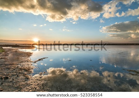 Reflection of clouds in the lake at sunrise.