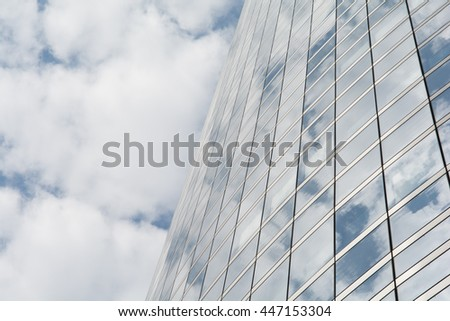 Reflection of clouds on a glass facade of a modern building