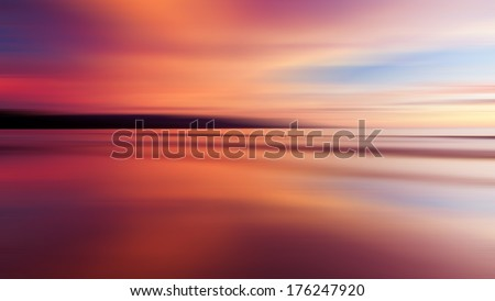 Reflection of colorful sunset with long exposure effect, motion blurred - stock photo