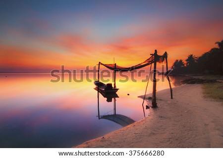 Reflection of Fisherman boat parking under the floating garage at Jubakar Beach Tumpat Kelantan. Copy Space Area - stock photo