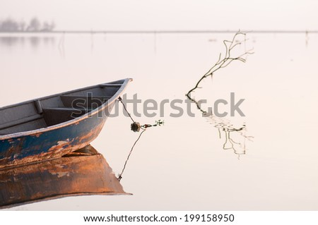 Reflection of Front Boat in Calm Lake