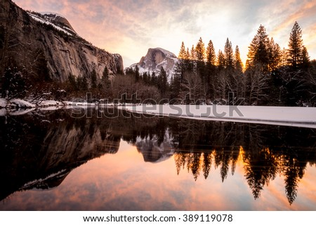 Reflection of half dome at Yosemite National park This is the best sunrise spot for the half dome. (the picture may be blur due to the light but I would like to focus on the color of the sky)  - stock photo