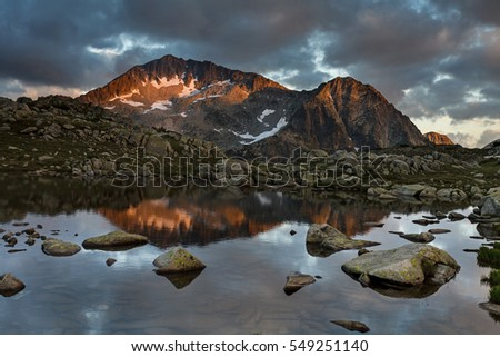 Reflection of Kamenitsa Peak at sunset, Pirin Mountain, Bulgaria