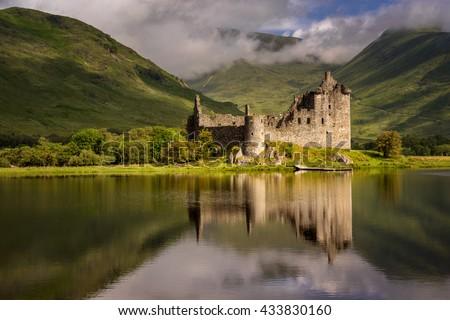 Reflection of Kilchurn Castle in Loch Awe, Highlands, Scotland - stock photo