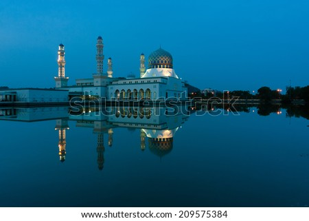 Reflection of Kota Kinabalu mosque at blue hour in Sabah, East Malaysia, Borneo - stock photo