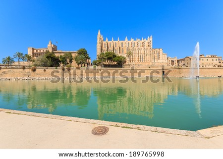 Reflection of La seu Cathedral and Almudaina Palace in a lake ,Palma de Mallorca, Spain  - stock photo