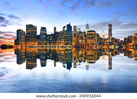Reflection of Manhattan skyline at twilight. - stock photo