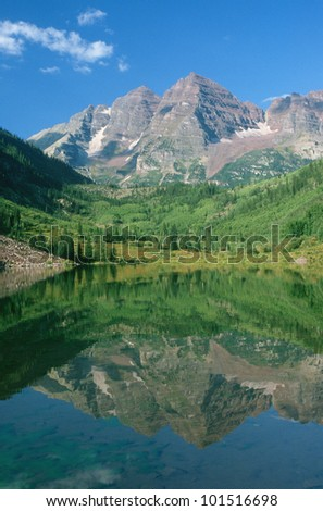 Reflection of Maroon Bell Mountain in Maroon Lake, Colorado - stock photo