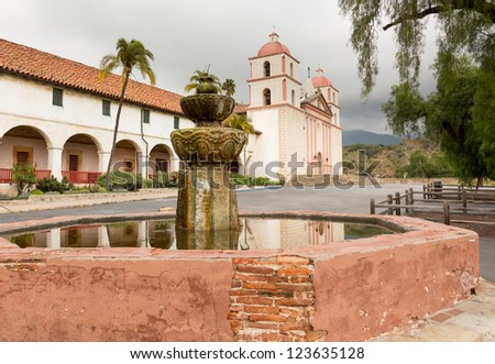 Reflection of Mission Santa Barbara in California exterior on stormy day with clouds - stock photo
