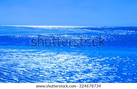 Reflection of moonlight on the surface of the sea  - stock photo
