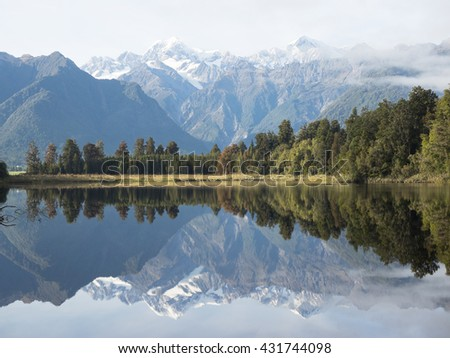 Reflection of mountains in the lake Matheson, South Island New Zealand