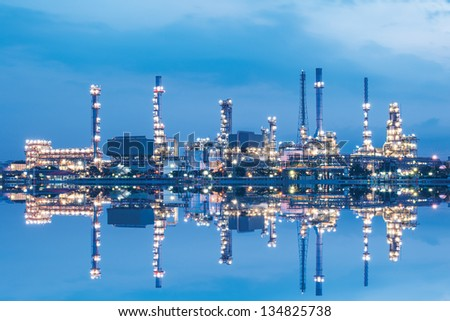 Reflection of oil refinery plant - stock photo