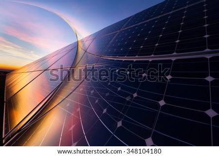 Reflection of picturesque clouds on  photovoltaic modules - stock photo