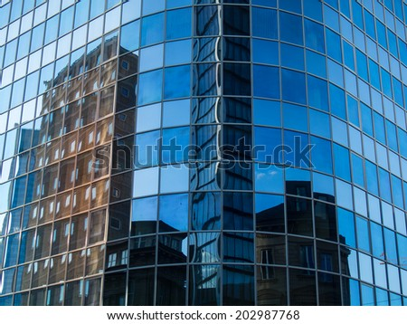 Reflection of skyscrapers in another one, Frankfurt, Germany Office buildings in one of the most fascinating financial areas of Europe - stock photo