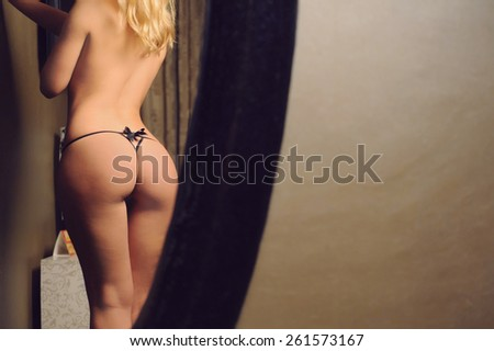 reflection of slim woman in mirror