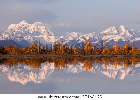 Reflection of snow mountain in Denali - stock photo