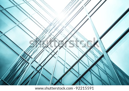reflection of sunny ray in business office windows - stock photo