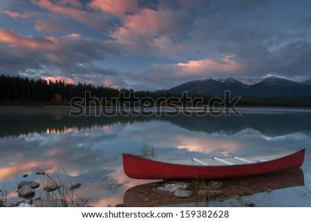 Reflection of sunrise in Patricia Lake, Jasper, Alberta, Canada - stock photo