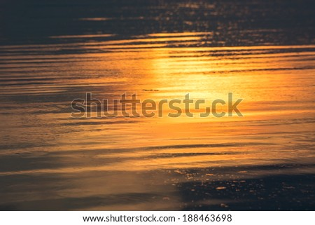 reflection of sunset in the sea. - stock photo
