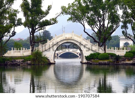 reflection of the bridge in the lake, Guilin, China - stock photo