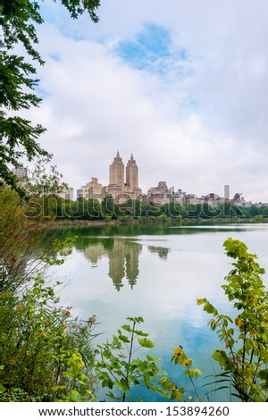 Reflection of the buildings in the lake of central park in New York