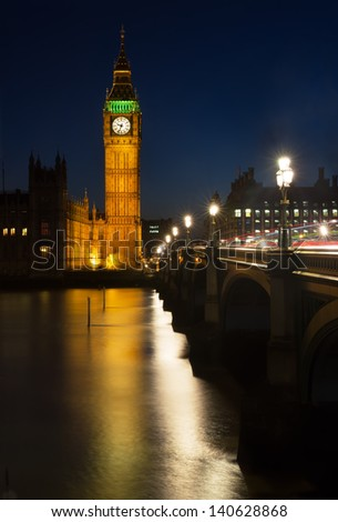 Reflection of the Elizabeth Tower (Big Ben) of the Palace of Westminster in the River Thames - stock photo