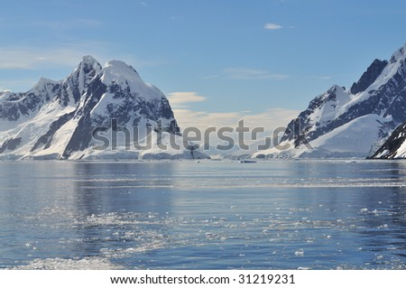 Reflection of the mountains in Antarctica - stock photo