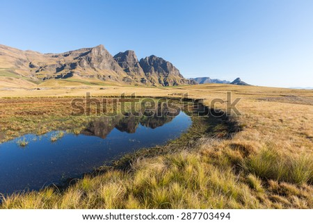 Reflection of the peaks in a pool - stock photo