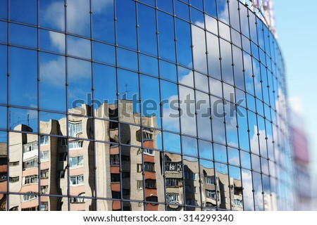 reflection of the sky in the glass windows - stock photo