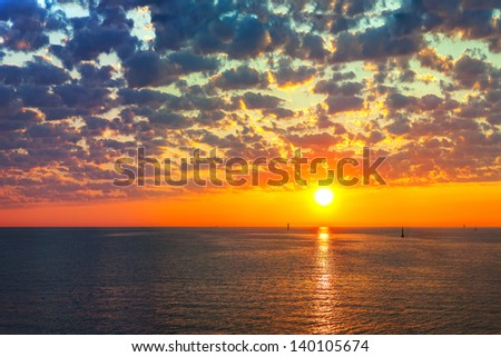 Reflection of the sun at sunrise at sea
